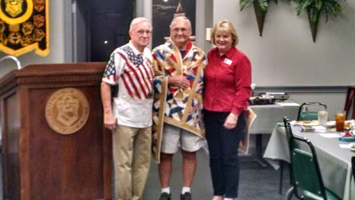 Tommy Forest, left, and Debbie Stone, both of Quilts of Valor in Anderson, presented a quilt to Anderson Sertoma Club member Larry Queen, center. Stone made the quilt.