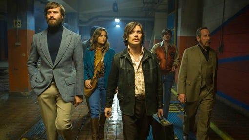 "This image released by A24 shows, from left, Armie Hammer, Brie Larson, Cillian Murphy, Sam Riley and Michael Smiley in a scene from ""Free Fire."""