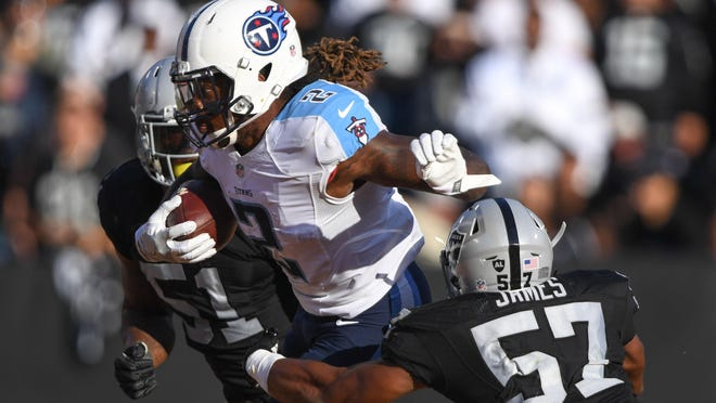 Titans running back Derrick Henry (2) powers past Raiders outside linebacker Cory James (57) during the second quarter on Aug. 27, 2016.