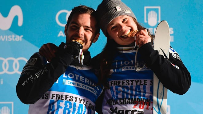 Aerials men's and woemen's World Champions, Jonathon Lillis, left, and Ashley Caldwell of the United States pose with their medals after the podium ceremonies of the aerials finals in the FIS Snowboard and Freestyle Ski World Championships 2017 in Sierra Nevada, Spain on March 10, 2017.