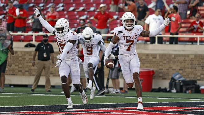 Texas safety Caden Sterns (7) celebrates after his interception on the last play of the Longhorns' 63-56 overtime victory Saturday against Texas Tech at Jones AT&T Stadium. Texas rallied from a 56-41 deficit with in the last 3 minutes, 13 seconds of regulation.