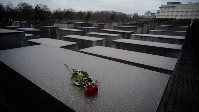 A red rose lies on a slab of the Holocaust Memorial to commemorate the victims of the Nazis in Berlin on Jan. 27, 2019. The International Holocaust Remembrance Day marks the liberation of the Auschwitz Nazi death camp on Jan. 27, 1945.