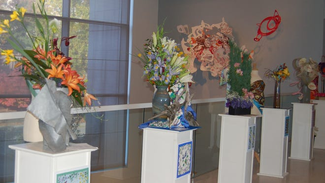 This group of arrangements on pedestals is the Scarf Class at the 2012 Show.