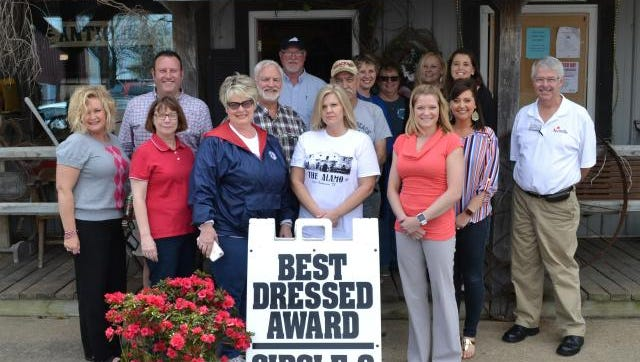 The Sturgis Chamber of Commerce recently presented its best Dressed Award to the Circle O Farm Center.  On hand for the presentation were, front row, from left, Nyra Syers; Lisa Jones; Sue O'Nan; Latasha Hawkins; and Chamber President Dr. Kate Baker.  Back, Doug Rodgers; Dennis O'Nan; Chuck Voss; Bill McGlothin; Charity Wallace; Jonell Blandford Tami Steward; Lindsay Jenkins and Chuck Stinnett
