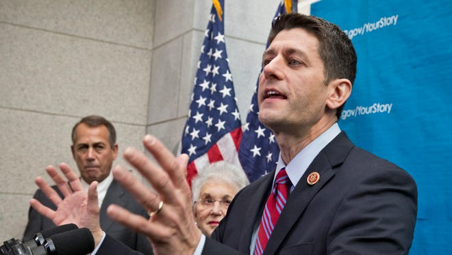 House Budget Committee Chairman Rep. Paul Ryan, R-Wis., answers reporters questions during a news conference on Capitol Hill in Washington.
