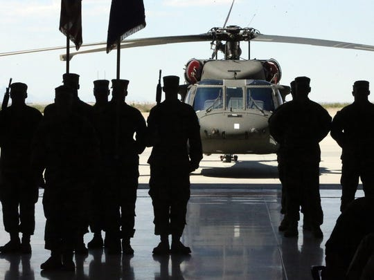 A UH-60 Black Hawk helicopter sits outside a hangar during a casing ceremony for 3rd Battalion, 501st Aviation Regiment, Combat Aviation Brigade, 1st Armored Division on Tuesday at Fort Bliss.