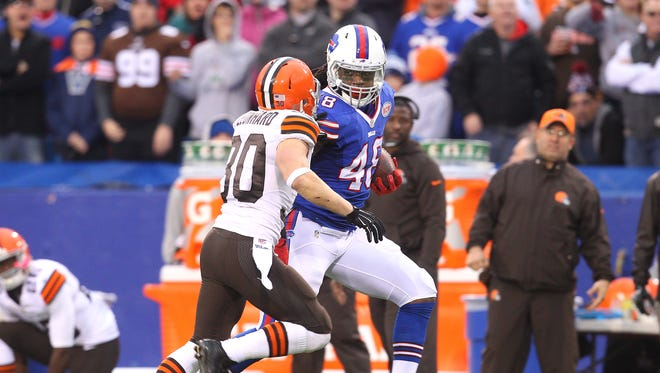 Bills TE MarQueis Gray (48) rumbles for a 41-yard reception against Brown's Jim Leonard (30).