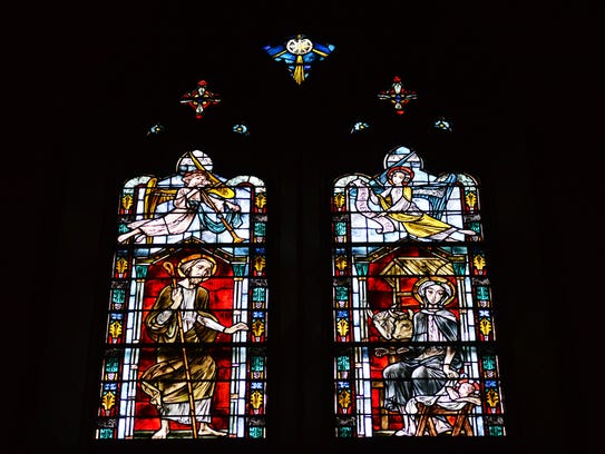 A stained glass scene of the birth of Jesus at the