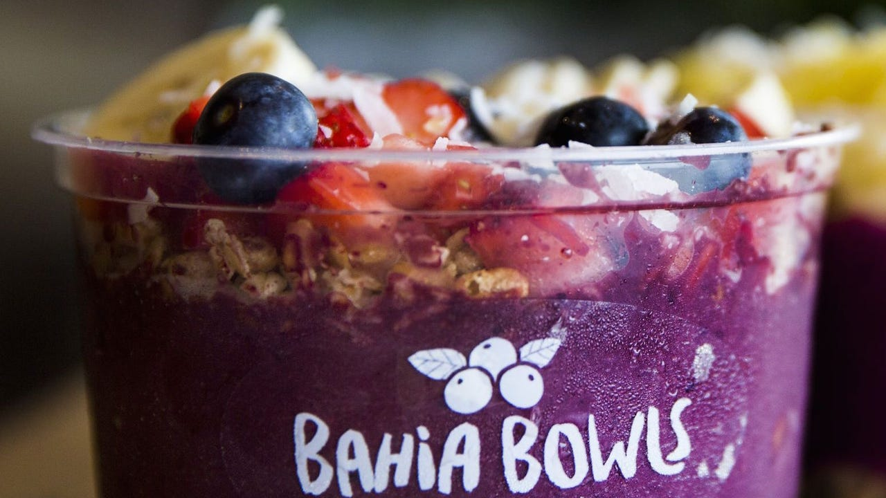 The team at Bahia Bowls make their delicious and healthy Pitaya Bowl at their flagship store in Estero. The new açaí cafe specializes in customizable smoothies and fruit bowls.