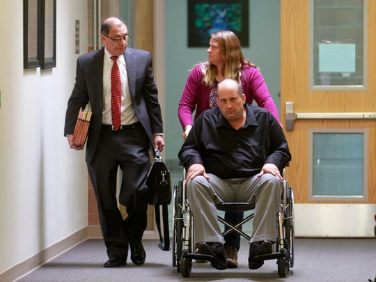 At right, Bobby Willis is escorted to court by his attorney, Bob Cooper, left, and his ex-wife, Carrie Willis, on Friday at the Farmington District Court.