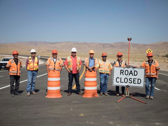 Crews stand on the USA Parkway just before it opened