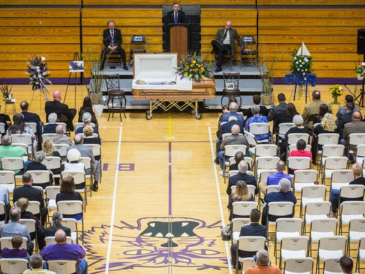 Pastor Allie Craycraft speaks during the funeral service