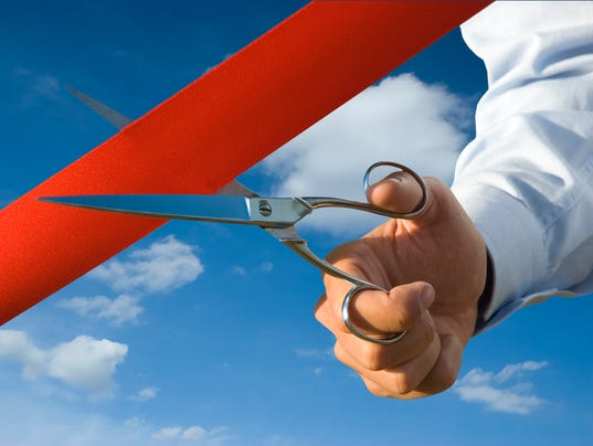 Ribbon cutting stock photo