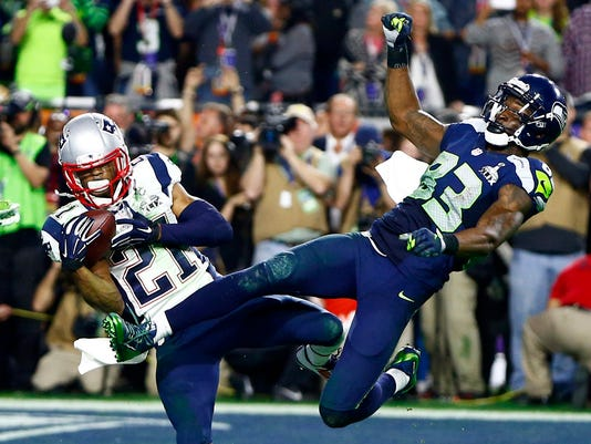 New England Patriots' Butler intercepts pass meant for Seattle Seahawks' vs Seattle Seahawks' Lockette at the Superbowl in Glendale
