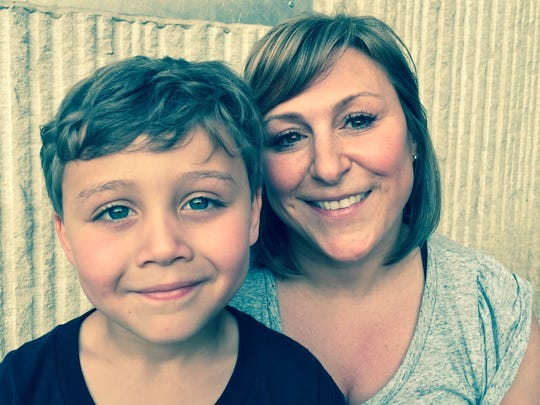 Michelle Augustine of Elmira is shown with her son, Chase Christian, whose name was chosen for first grade at Finn Academy.