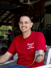 Naples resident and well-known swamp buggy driver Tyler Johns sits for a portrait at his home Saturday in Naples. Johns lost his arm in an airboat accident only two weeks ago on May 8, 2016. The swamp buggy community has rallied together to help pay off the families medical bills. Despite his circumstances Tyler is incredibly positive about the whole experience and grateful for the overwhelming support. 'What else can you do. I always look forward,' Tyler said. 'I couldn't ask for better friends.' (Luke Franke/Staff)
