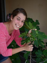 Naples resident and FGCU student Maryssa Pallis with a papaya seedling. She wants to feed the world, using sustainable micro-agriculture. Lance Shearer/Citizen Correspondent