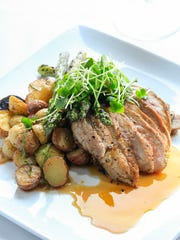 The skillet-seared duck breast had layers of flavors in it's sauce.