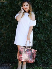 Ruya Kirac modeling an outfit for her blog Sweet, Short