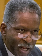 Democratic Sen. Reginald Tate of Memphis speaks during a Senate Education Committee hearing on affirmative action in public colleges and universities in Nashville, Tenn., on Wednesday, Feb. 13, 2013. (AP Photo/Erik Schelzig)