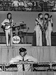 "The Beatles performed at 4 and 8:30 p.m. at the Mid-South Coliseum in Memphis, Friday, August 19, 1966. The Commercial Appeal reported that 20,128 people ""heard the Liverpudlians bow to Dixie."" A total of 7,589 attended the afternoon show and 12,539 showed up at the evening concert. The Cyrkle, Bobby Hebb, The Ronettes and The Remains also were on the bill. Tickets cost $5.50. According to the newspaper, the Beatles — John Lennon, Paul McCartney, George Harrison and Ringo Starr — wore ""modish-dull gray suits"" for the afternoon show and ""dark green creations with chartreuse shirts"" for the evening concert. A chain-link fence surrounded the stage. Across town, a crowd of more than 8,000 filled the Auditorium North Hall and part of the South Hall for the Memphis Christian Youth Rally. This was provoked by Lennon's statement that the Beatles were more popular than Jesus Christ. (By Robert Williams / The Commercial Appeal)"