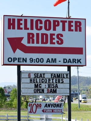A sign for Smoky Mountain Helicopters on Winfield Dunn Parkway in Sevierville.