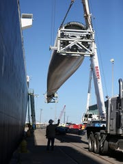 Rachel Denny Clow/Caller-Times  Wind turbine pieces are unloaded from a ship in the Port of Corpus Christi in this 2016 file photo. The port says its cargo the first six months of 2018 is on pace to establish a record.
