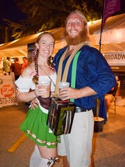 Tara Courter and Michael Cox pose with their beer at the 2016 Oktoberfest at the Cape Coral German-American Social Club.