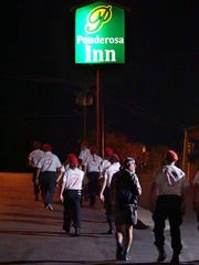 Guardian Angels march through the Ponderosa Inn parking lot on their way toward downtown Redding as part of their patrol in November 2016. (Hung Vu/Special to the Record Searchlight)