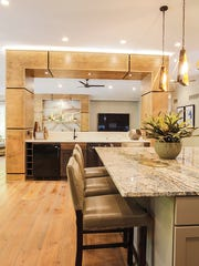Longo made structural columns in the kitchen into a