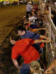 Children wait for the Dash for Cash game to begin at