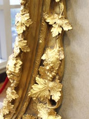 During the restoration, the entire mirror was covered in 22-karat gold leaf, as it had been while at the hotel in the 1800s.