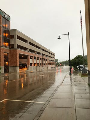 Light rain continues to soak the streets of downtown Appleton after a morning of storms.