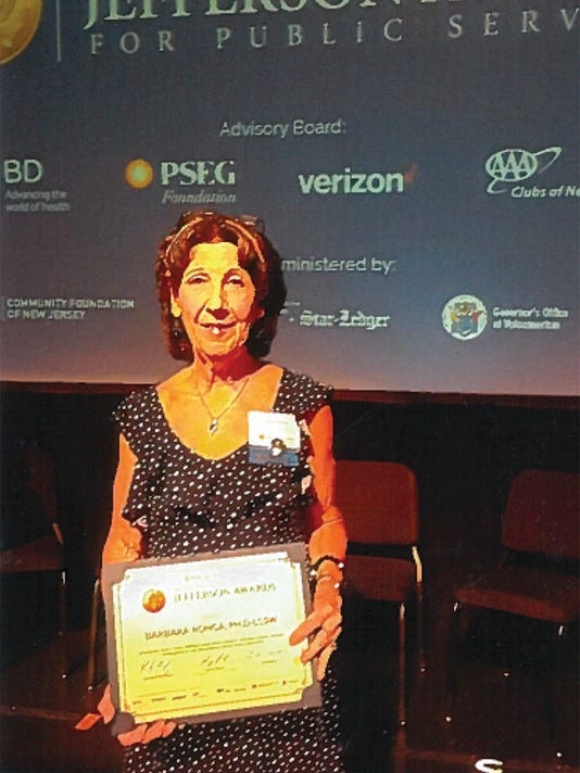 Ronca presented as honoree at ceremony PHOTO CAPTION