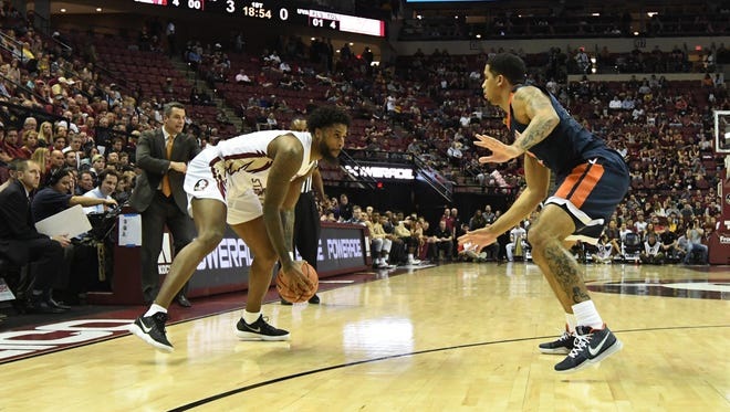 FSU senior forward Phil Cofer (0) handling the ball on offense during the first minutes of FSU's matchup against Virginia on Wednesday.