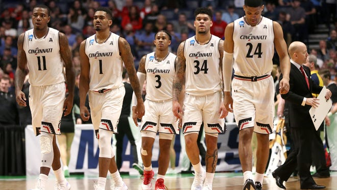 From left: Cincinnati Bearcats forward Gary Clark (11), guard Jacob Evans (1), guard Justin Jenifer (3), Cincinnati Jarron Cumberland (34) and forward Kyle Washington (24) take the court in the final moments of the second half of the first-round NCAA Tournament game between the Cincinnati Bearcats and the Georgia State Panthers, Friday, March 16, 2018, at Bridgestone Arena in Nashville. Cincinnati Bearcats won 68-53.