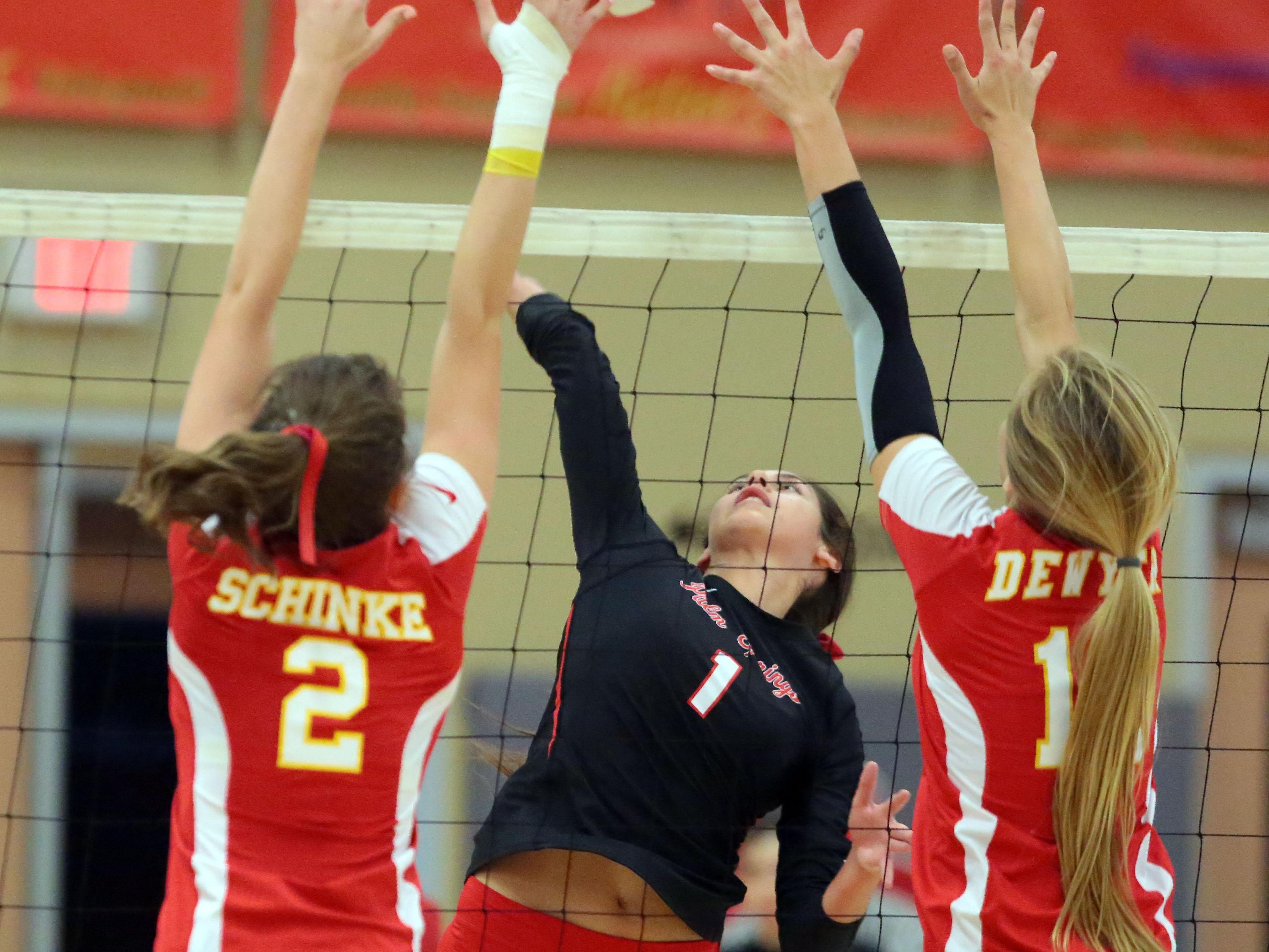 Palm Springs' Elena Eckhardt spikes the ball against Palm Desert on Thursday in Palm Desert.