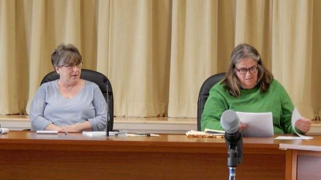 Ogunquit Town Clerk Chris Murphy, left, watches as Nancy Breen reviews submitted evidence during a public hearing Thursday, Feb. 27, 2020, at the Dunaway Community Center in Ogunquit, Maine concerning an allegation that Breen doesn't reside in town and is therefore ineligible to vote in town. Murphy determined that Breen is ineligible to vote in town because she failed to provide satisfactory proof of residency, but the Select Board reversed Murphy's decision.