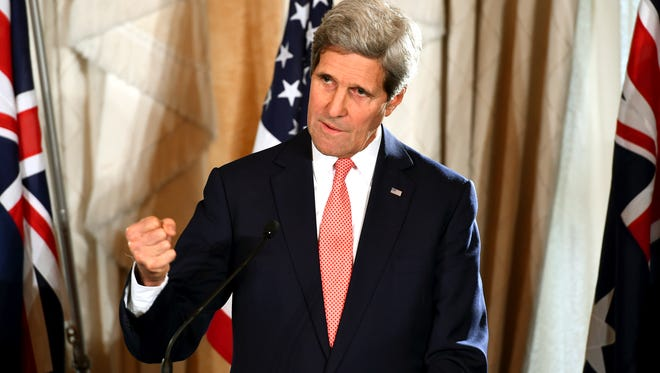 Secretary of State John Kerry gestures as he speaks to the media on Aug. 12, 2014.