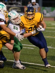 Novi's Ethan Carter (left) made the tackle, but lost