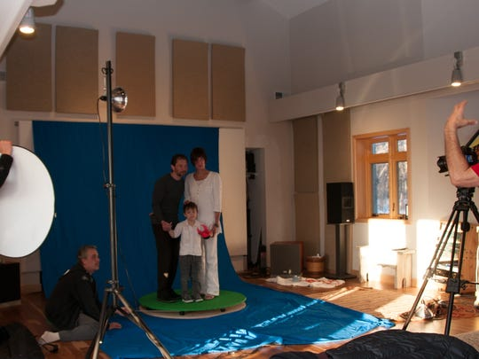 A rotating platform built by Joel Thomas of Sister Bay in Tim Erskine's studio allowed Erskine to create some special effects with a green screen behinnd the platform. Here, Erskine, right, Joel Kersebet and Chris Opper, left, direct Peter Ciesla, Bobby Opper and Alicia Kersebet, who are on the platform.