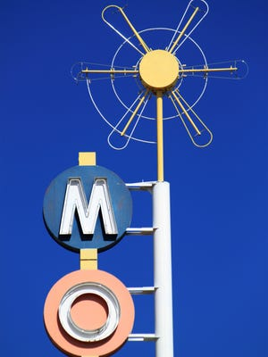 This neon sign has been refurbished along Route 66 in Albuquerque, N.M. University of New Mexico associate dean and architecture professor Mark Childs pointed to the detail of this motel sign as a classic example of the midcentury designs used by the sign makers and business owners to attract customers.