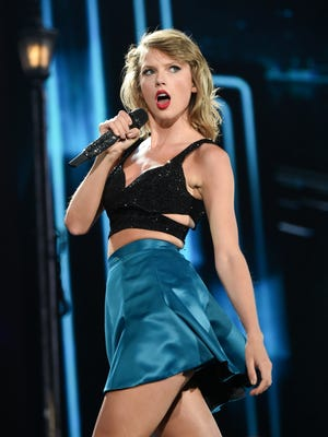 "In this July 10, 2015 file photo, Taylor Swift performs during her ""1989"" world tour at MetLife Stadium in East Rutherford, N.J."