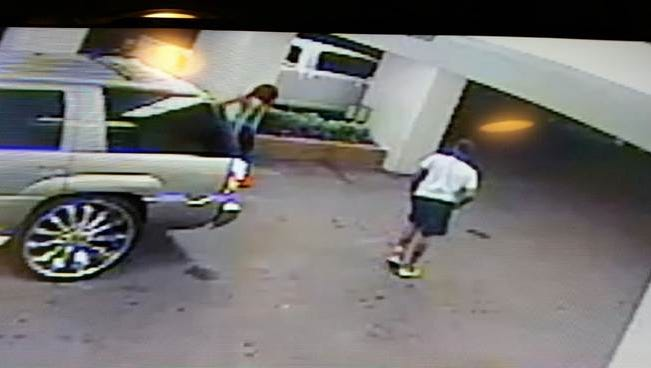 The MBI is looking for the two photographed people in connection with the killings of two HPD officers.