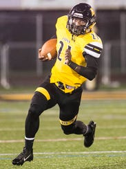 Red Lion's Paul Jones, runs the ball during the first