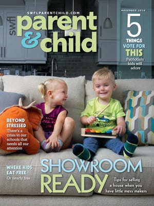 Hazel and Henry Holland, of North Fort Myers, twins who turn 3 in December, model for the cover of Southwest Florida Parent & Child