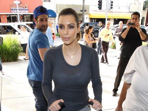 Kim Kardashian wheels a stroller on Dec. 16 in Los Angeles.