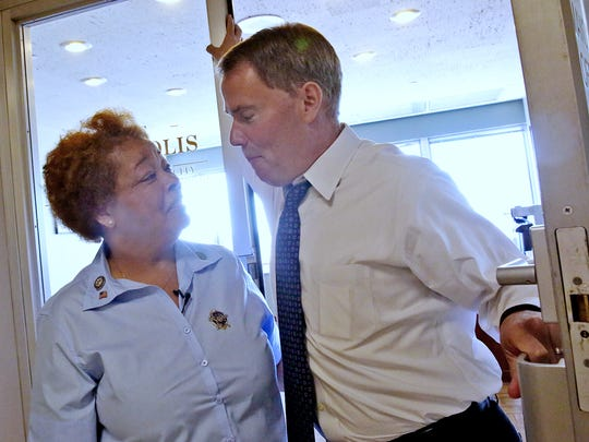 Denise Cummings, left, a service elevator operator at the City-County Building since 1981, laughs with Mayor Joe Hogsett. Cummings has transported mayors to the 25th floor since Bill Hudnut's administration.