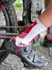Simon Lewis' mountain bike is covered with mud as he practices at Percy Warner Park in Nashville. He will compete in a national mountain bike race in California this week.