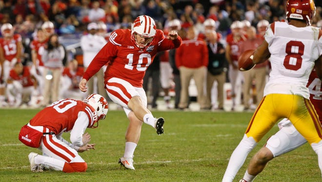 Wisconsin's  Rafael Gaglianone kicks a field goal during the second half of the Holiday Bowl on Wednesday. Wisconsin won 23-21.